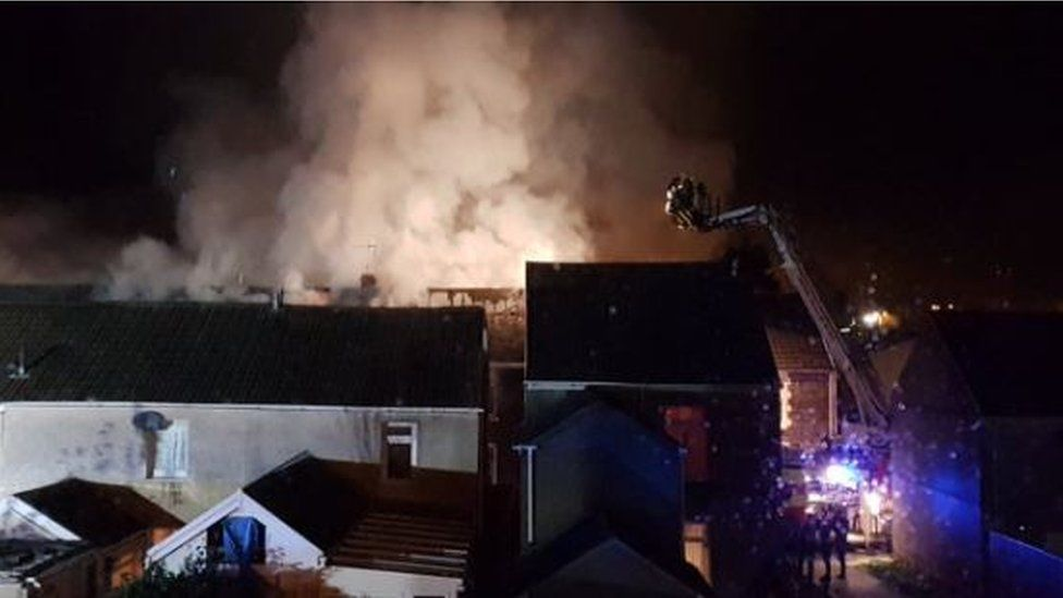 Large plumes of smoke coming from the house fire in Lombard Street, Neath