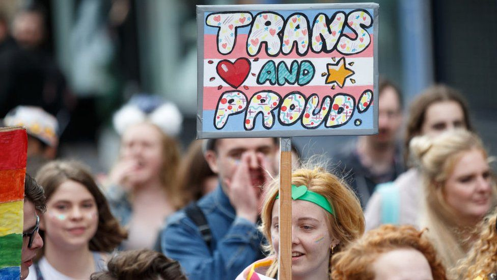 """""""Trans and proud"""" sign at Glasgow Pride"""