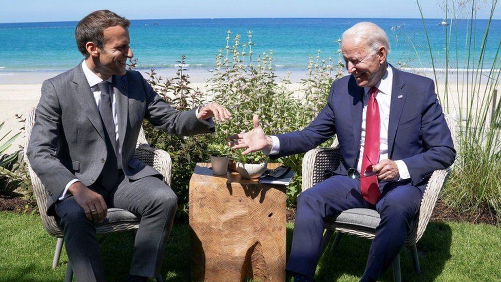 Emmanuel Macron and Joe Biden relax between sessions of the G7 summit in Cornwall, 12 June