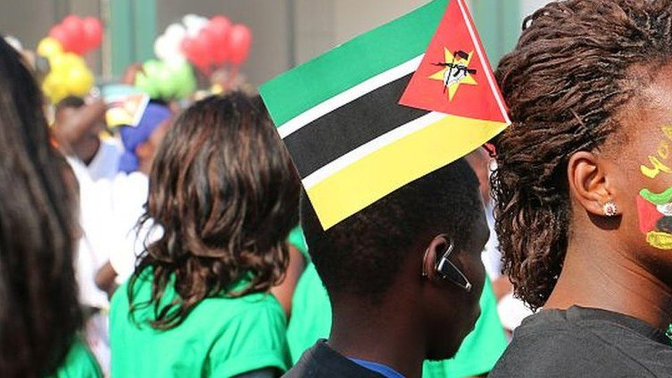 Mozambicans displaying the national colours