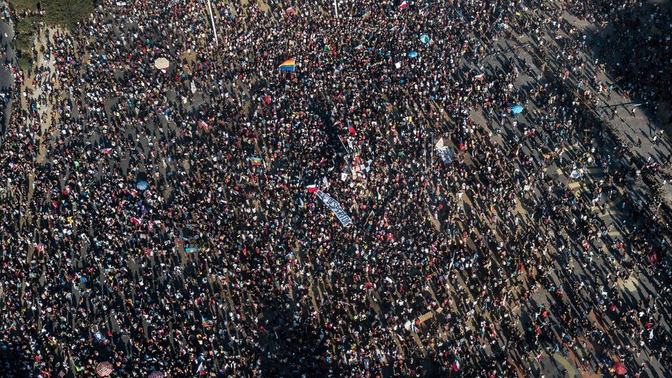 An aerial view of people demonstrating against the government of Chilean President Sebastian Pinera, in Santiago on 12 November, 2019.