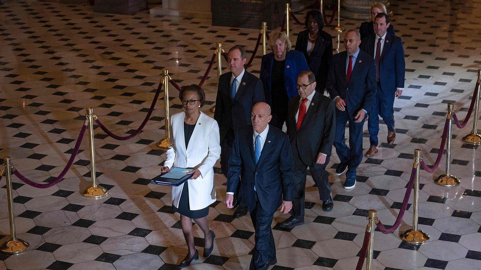 House Managers walk to the US Senate to deliver the Articles of Impeachment against US President Donald Trump on Capitol Hill on January 15, 2020, in Washington, DC