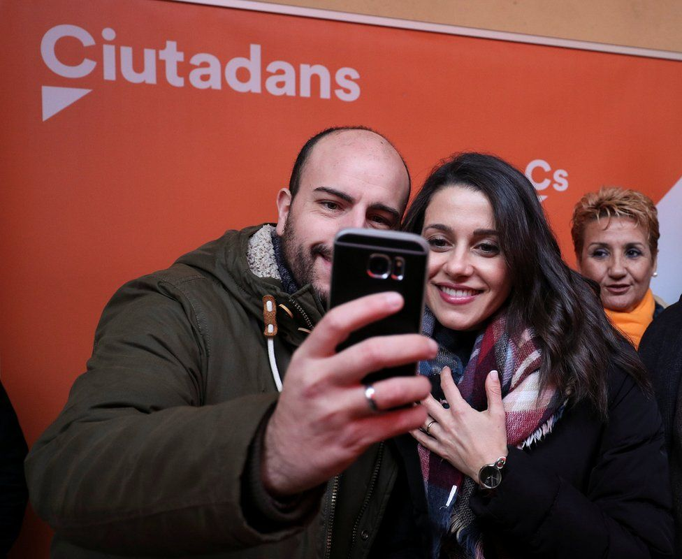 Catalan Cs leader Ines Arrimadas poses for a selfie with a supporter in Figueres, 15 December