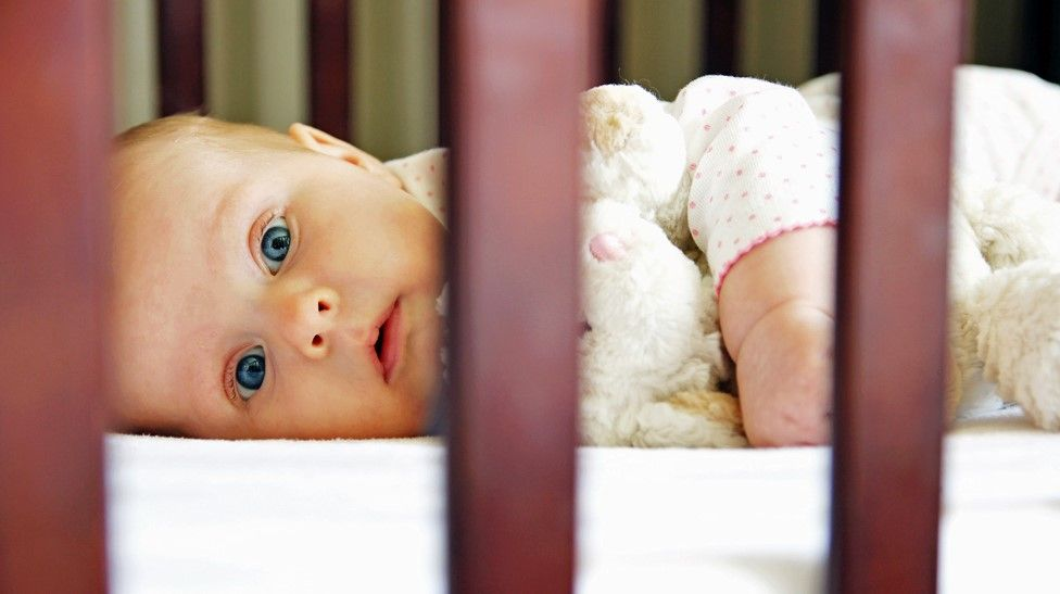 A baby in a cot