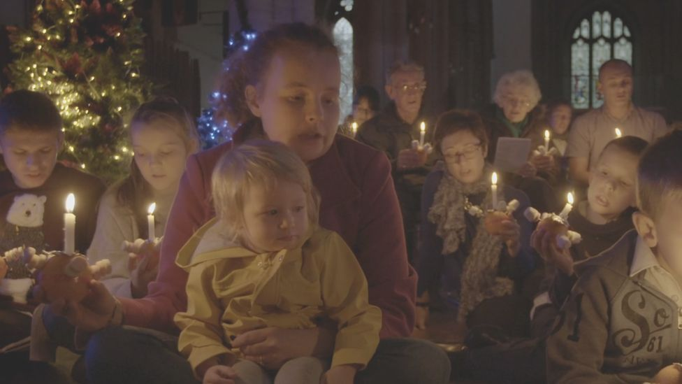 Children and parents at a Christingle service