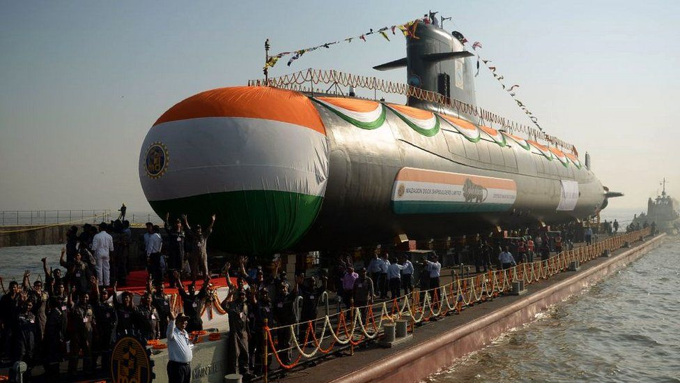 The Indian Navy's third Scorpene-class submarine, Karanj, is pulled into the Arabian Sea after its launch ceremony at the Mazagon Dock Shipyard in Mumbai on January 31, 2018