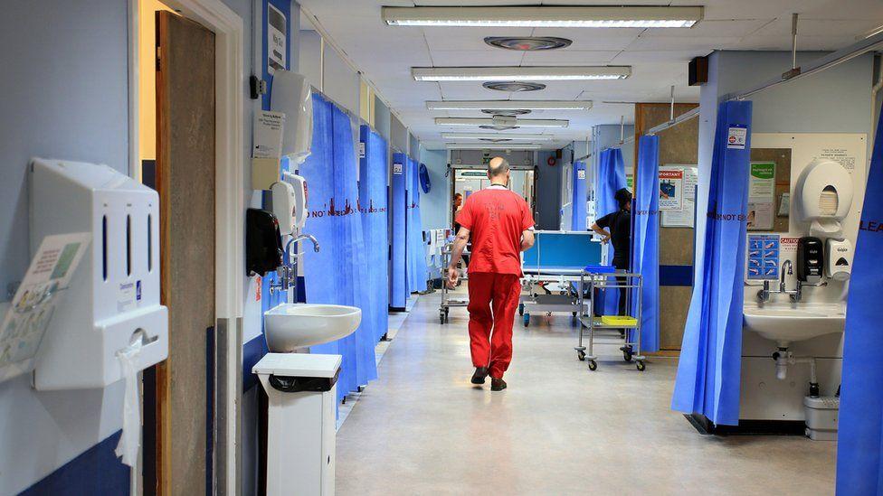 A doctor on a hospital ward