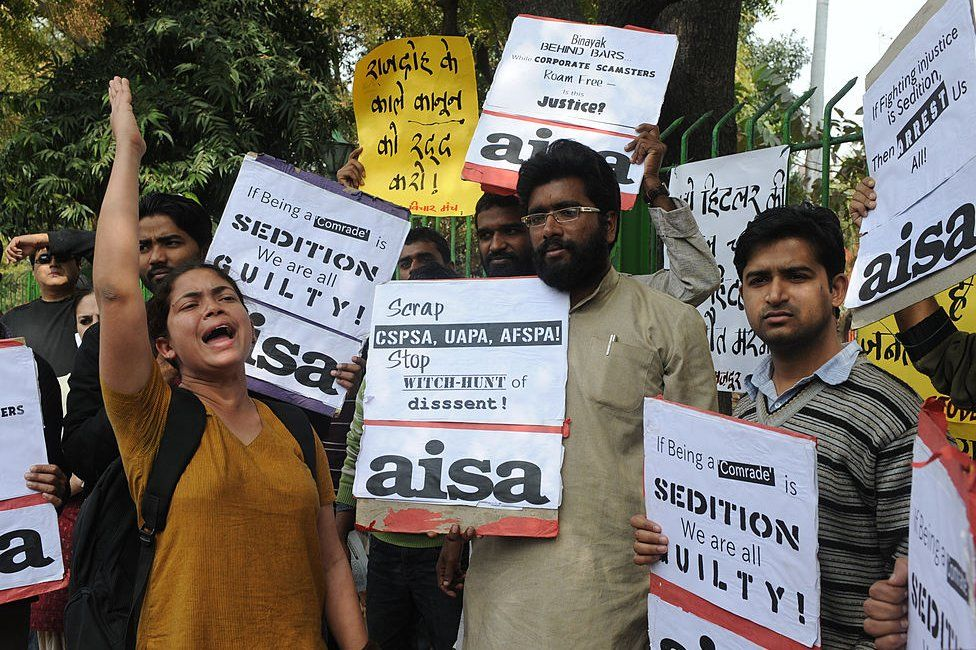 Indian college lecturers, teachers and political activists hold placards as they shout anti-government slogans in New Delhi on February 12, 2011 during a protest against the life sentence handed down to doctor and social activist, Binayak Sen, on charges of sedition in India's Chhattisgarh state. Amnesty International has described Binayak Sen as a 'prisoner of conscience' but the court insisted the doctor helped outlawed Maoist guerrillas in the insurgency-riven state. An Indian court on February 10 refused bail for Sen sentenced to life in prison on charges of helping Maoist insurgents, in a case that has drawn international condemnation.