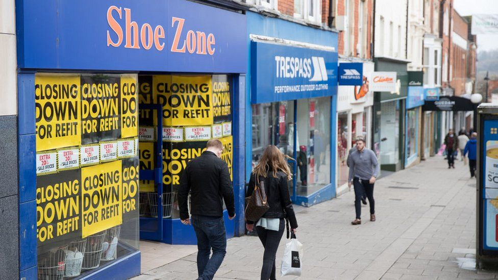 People walk past shops and retailers in the town centre of Yeovil