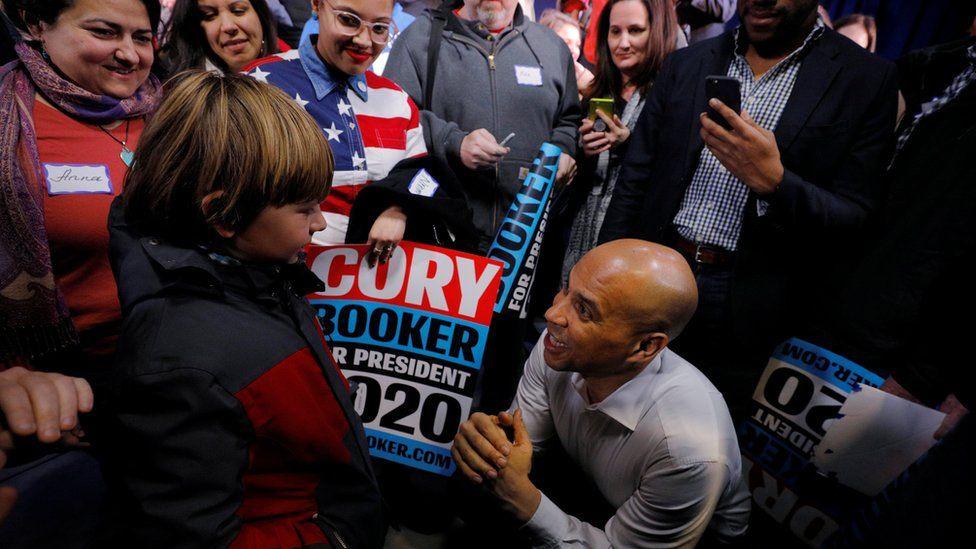 Cory Booker - kneeling in crowd