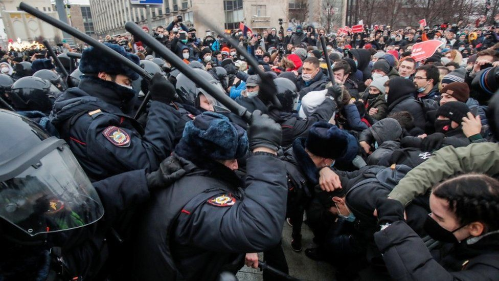 Law enforcement officers clash with participants using batons in Moscow protest