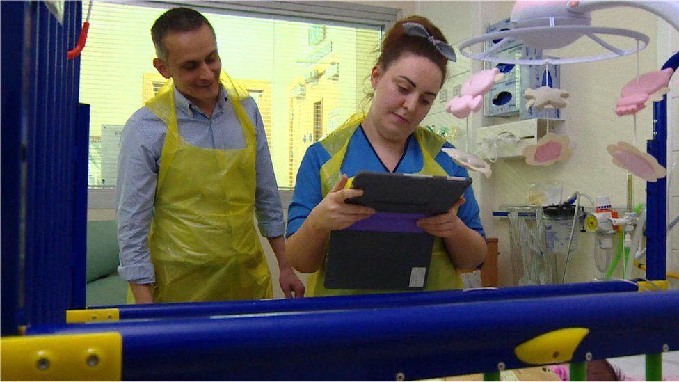 Doctor and nurse on neonatal ward in Glasgow