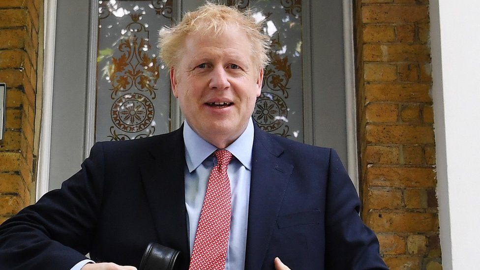 Boris Johnson leaving his London home