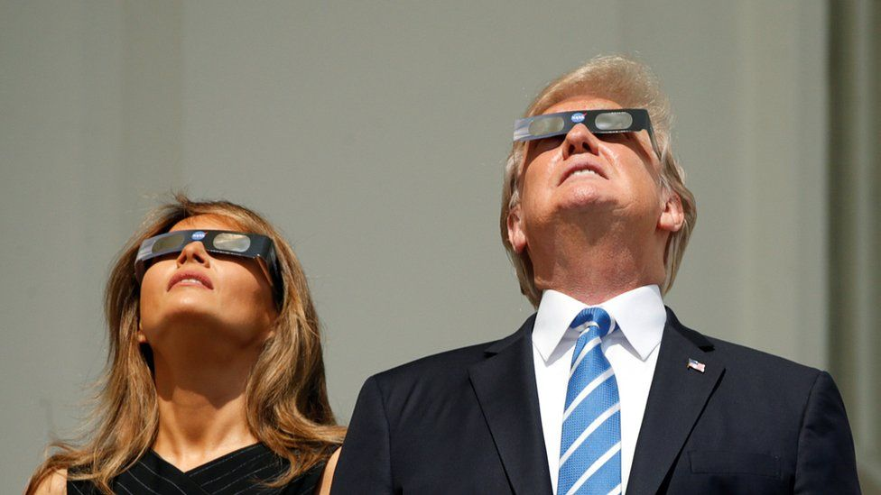 The Trumps look at the sun