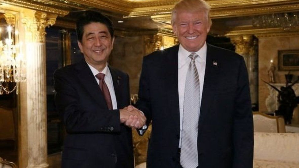 Prime Minister Abe and President Trump, the new US president, at Trump Tower in New York