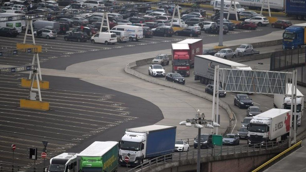 Cars and freight unload from a ferry at the Port of Dover in Dover, Britain