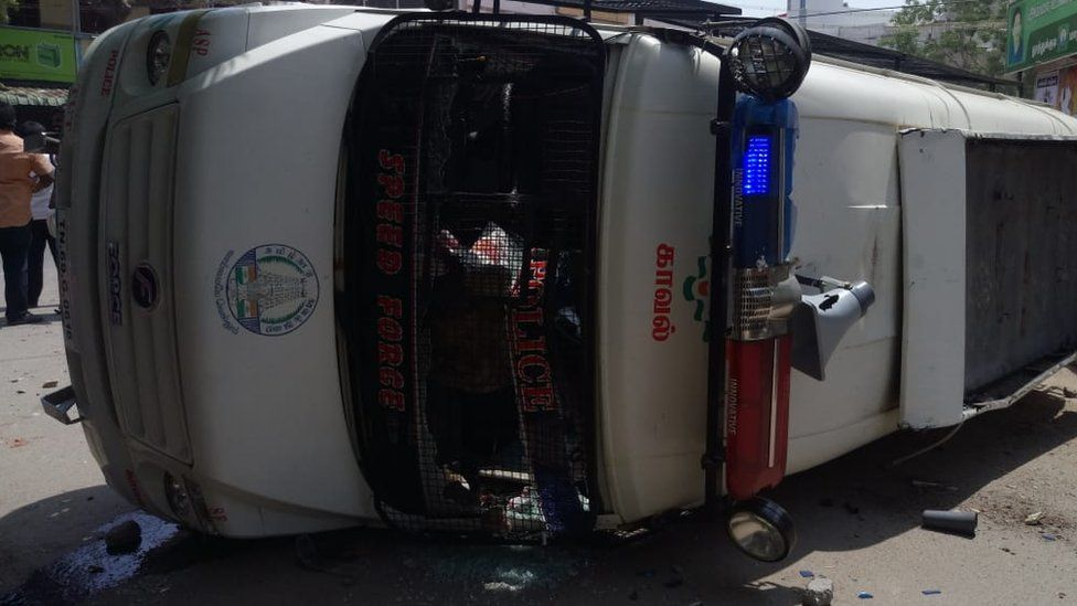 Police car overturned in protests