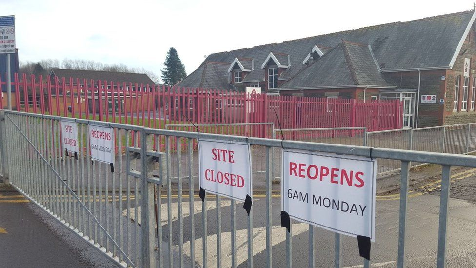 Signs to say the site is closed have been placed on the school gates