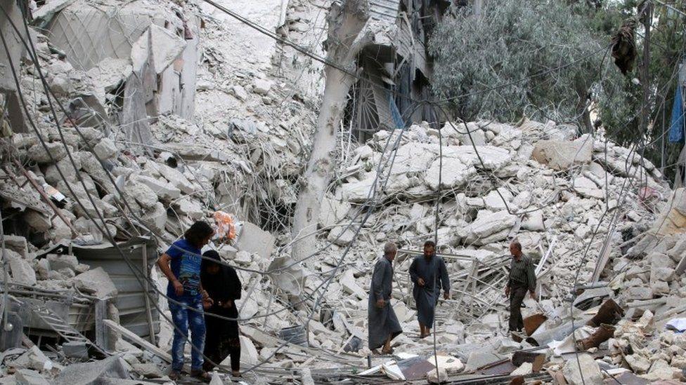 Aftermath of air strike on rebel-held Tariq al-Bab neighbourhood of Aleppo, 23 September