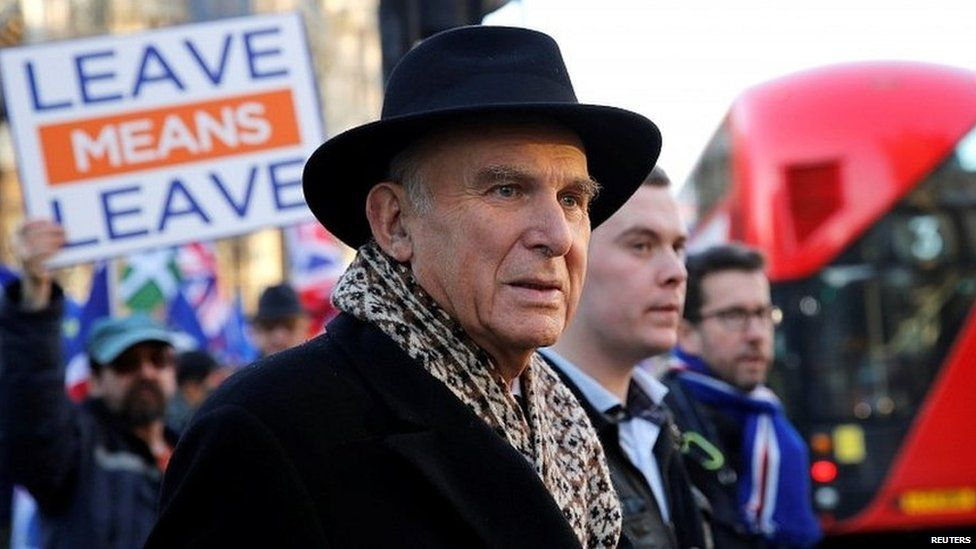 Sir Vince Cable, with a Brexit supporter in the background