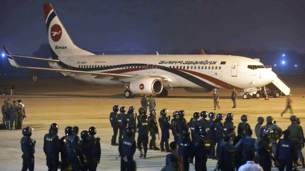 Police forces surround the hijacked Dubai-bound Bangladesh Biman plane on the tarmac after an emergency landing at the Shah Amanat International Airport in Chittagong, Bangladesh, 24 February 2019