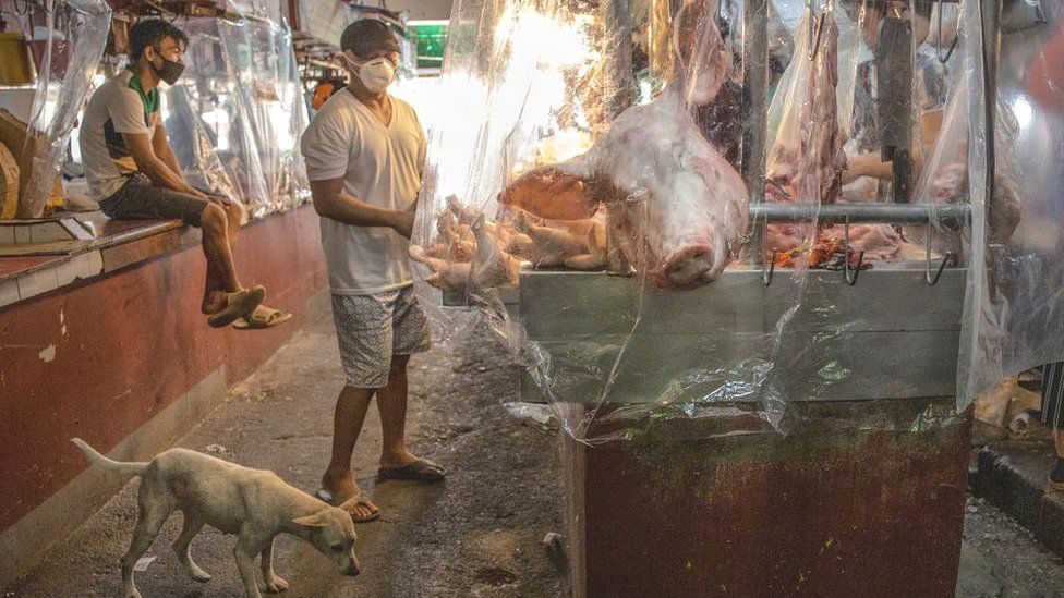 Wet market covered in plastic for social distancing