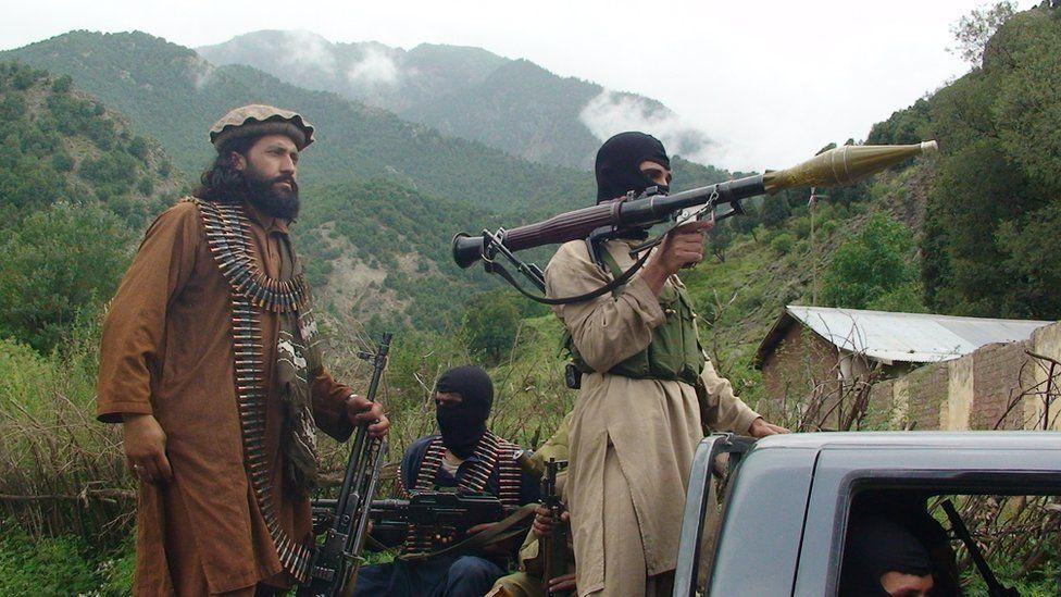 file photo taken on Sunday, Aug. 5, 2012, Pakistani Taliban patrol in Shawal in Pakistani tribal region of South Waziristan