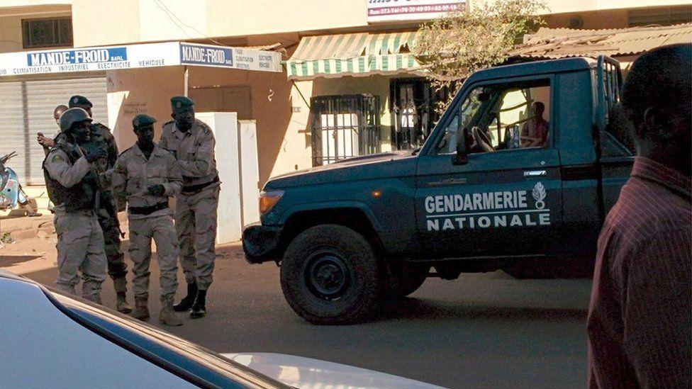 Security forces gather near the Radisson Hotel in Bamako, Mali.