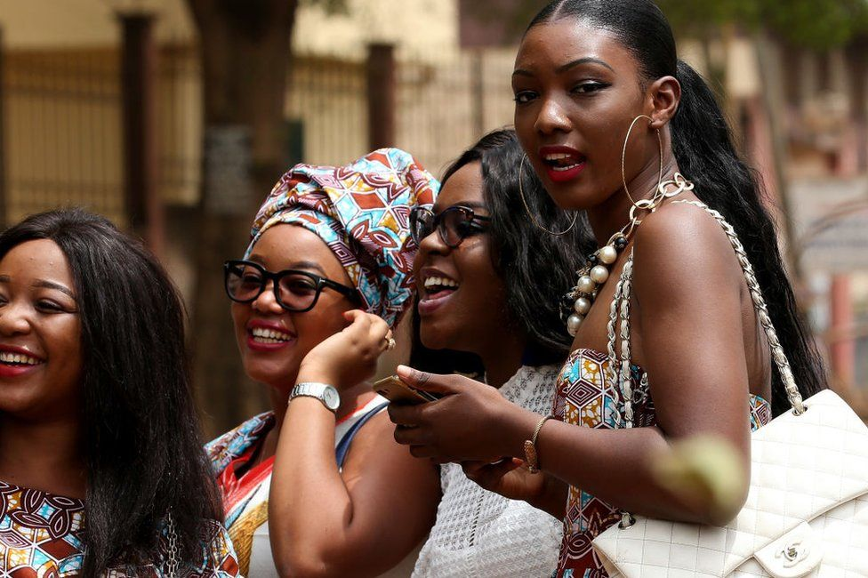 Girls laugh on February 17, 2018 in Yaounde, Cameroon.