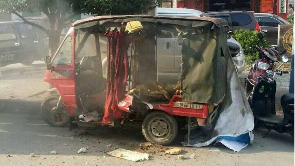 A vehicle is seen damaged after explosions hit Liucheng county, Guangxi Zhuang Autonomous Region, China, 30 September 2015