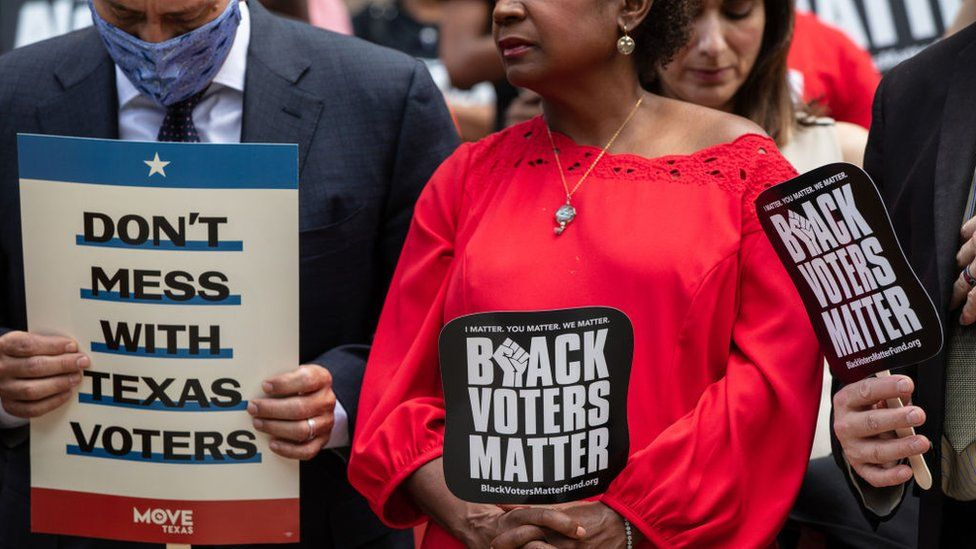 Members of the Texas House Democratic Caucus take part in a voting rights rally outside of the Texas State Capitol on the first day of the 87th Legislature's special session on July 8, 2021 in Austin, Texas