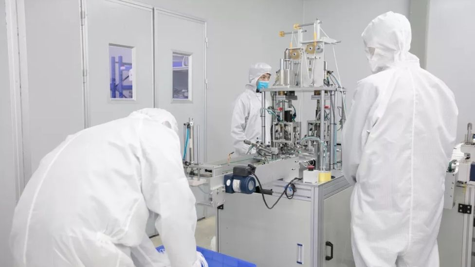Foxconn surgical mask making test production line.