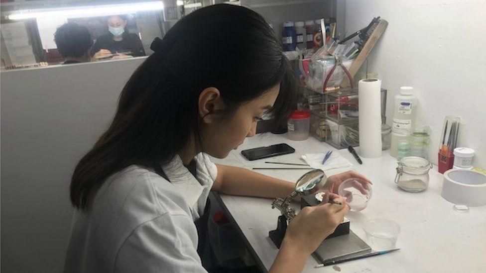 Woman works at medal-maker Royal Insignia