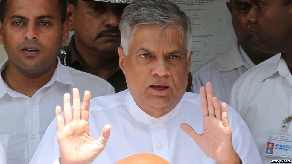 Sri Lankan Prime Minister Ranil Wickremesinghe of the United National Party gestures after casting his vote in the General election on August 17, 2015 in Colombo, Sri Lanka