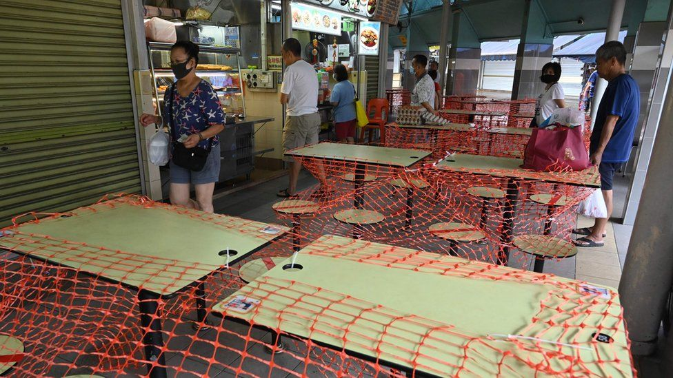 Cordoned off tables at a food court in Singapore