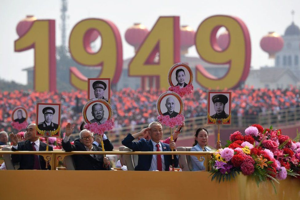 Relatives of revolutionary martyrs take part in the National Day parade in Tiananmen Square in Beijing on October 1, 2019, to mark the 70th anniversary of the founding of the People's Republic of China.