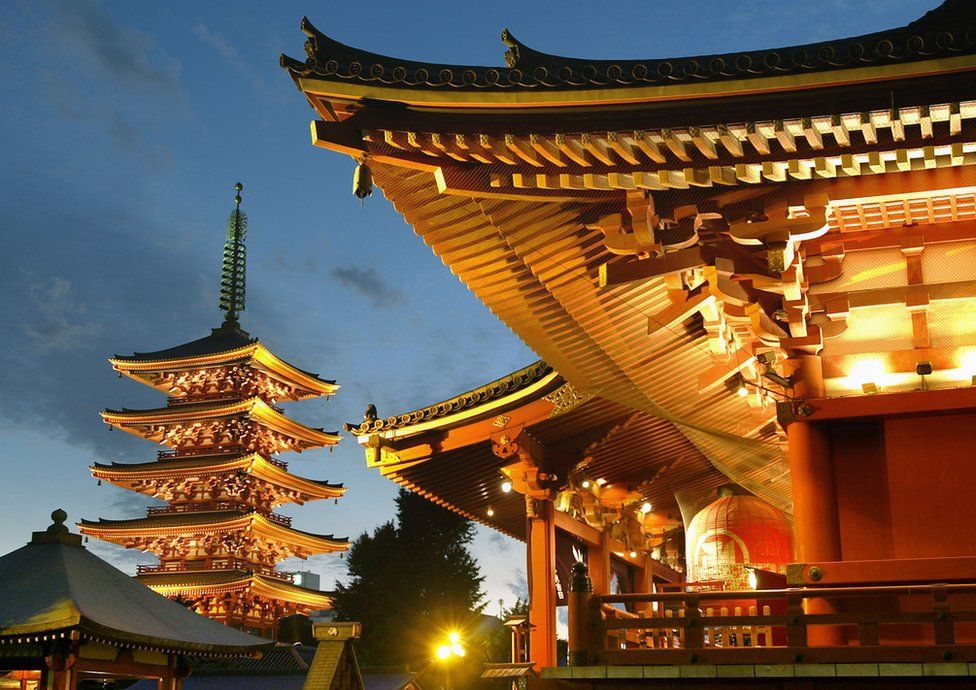 Tokyo's famous landscape Sensoji-temple (R) and a five-storied pagoda are lighted up in the night scene, 2 October 2003, to commemorate the 400th anniversary of Tokyo's establishment