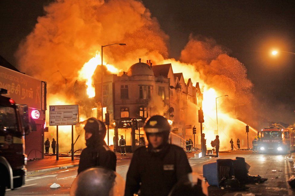 Firefighters battle a fire that broke out in Croydon, south London, on 9 August 2011