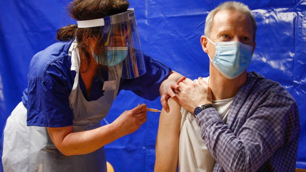 A man receives a Covid-19 vaccine at the vaccination centre at the Bournemouth International Centre in January