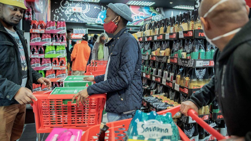 Customers buy alcohol at a liquor shop in Melville, Johannesburg