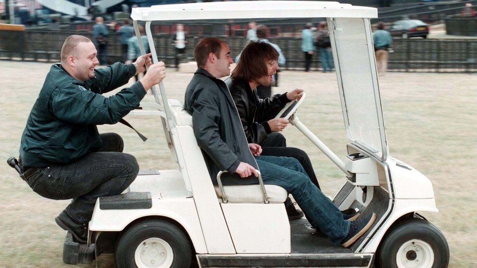 Oasis in a golf buggy