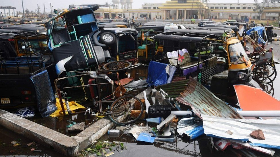 Damaged auto rickshaws are pictured in a pile in Puri, 4 May 2019