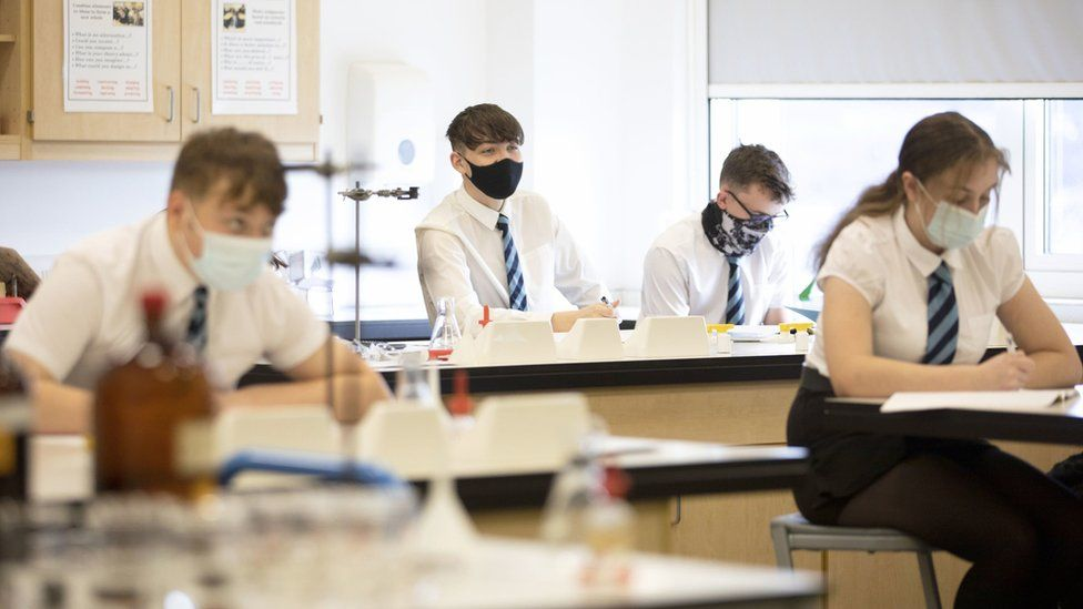 Secondary school pupils wearing masks in class