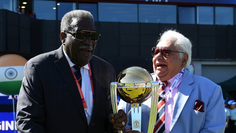 Former West Indies Cricketer Clive Lloyd and Former India Cricketer Farokh Engineer carry out the trophy prior to the national anthems