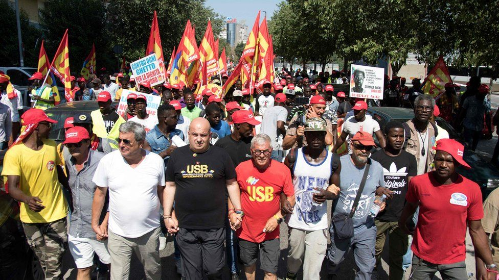Union members marching with migrant workers in Foggia August 2018