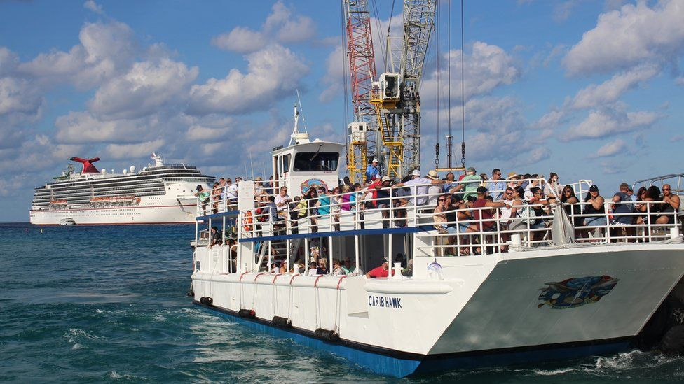 Tenders ferry tourists from the cruise liners to shore in Grand Cayman