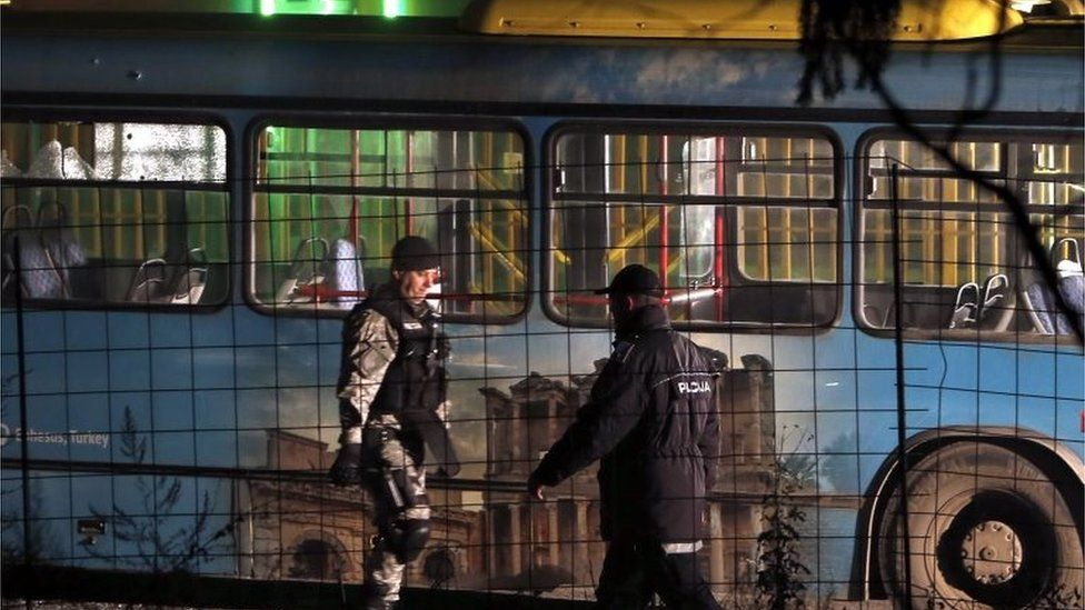 Bosnian police inspect a bus after the attack in Sarajevo. Photo: 18 November 2015