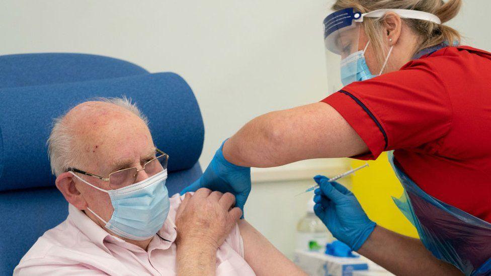 Man getting a vaccine against Covid