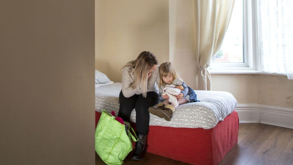 A woman and child in a shelter