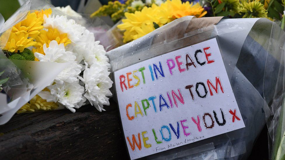 Floral tributes outside the home in Marston Moretaine, Bedfordshire, of 100-year-old charity fundraiser Captain Sir Tom Moore